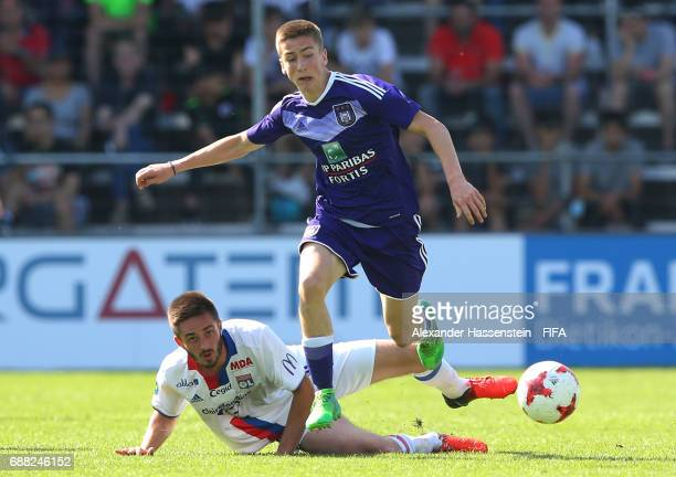 Alexis Saelemaekers of RSC Anderlecht goes past the challenge from Yoann Martelat of Olympique Lyonnais during the Final match between Olympique Lyon...