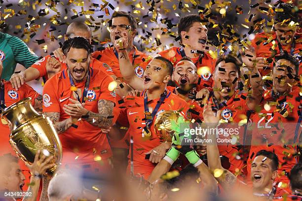 Alexis Sanchez #7 of Chile celebrates with team mates at the trophy presentation during the Argentina Vs Chile Final match of the Copa America...
