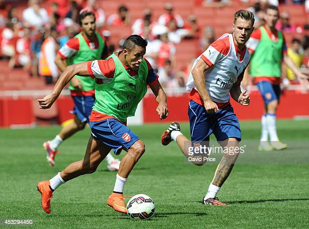 Alexis Sanchez and Aaron Ramsey of Arsenal in action during the Arsenal Training Session at Emirates Stadium on August 7 2014 in London England