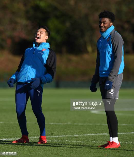 Alexis Sanchez and Ainsley MaitlandNiles of Arsenal during a training session at London Colney on December 9 2017 in St Albans England