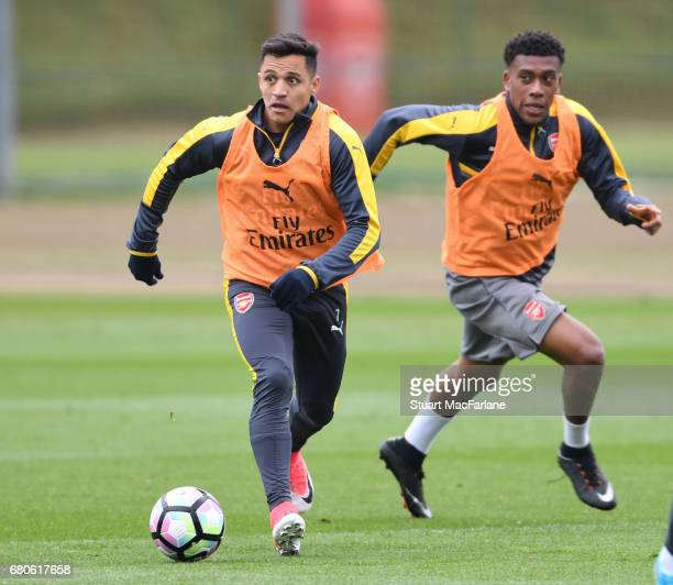Alexis Sanchez and Alex Iwobi of Arsenal during a training session at London Colney on May 9 2017 in St Albans England