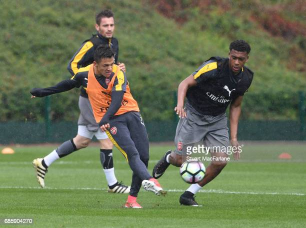 Alexis Sanchez and Alex Iwobi of Arsenal during a training session at London Colney on May 20 2017 in St Albans England