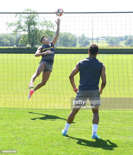 Alexis Sanchez and Alex OxladeChamberlain of Arsenal during a training session at London Colney on May 26 2017 in St Albans England