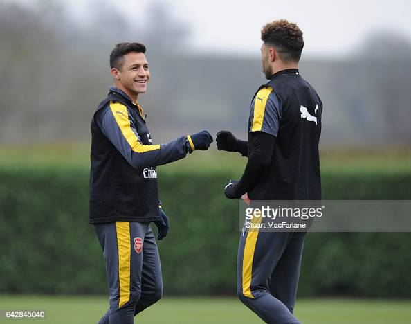Alexis Sanchez and Alex OxladeChamberlain of Arsenal during a training session on February 19 2017 in St Albans England