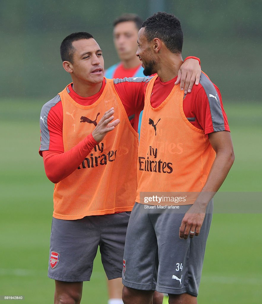Alexis Sanchez and Francis Coquelin of Arsenal during a training session at London Colney on August 19 2016 in St Albans England