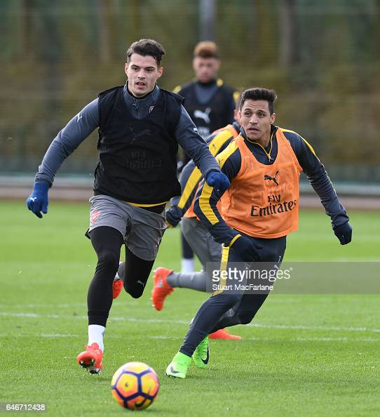 Alexis Sanchez and Gabriel of Arsenal during a training session at London Colney on March 1 2017 in St Albans England