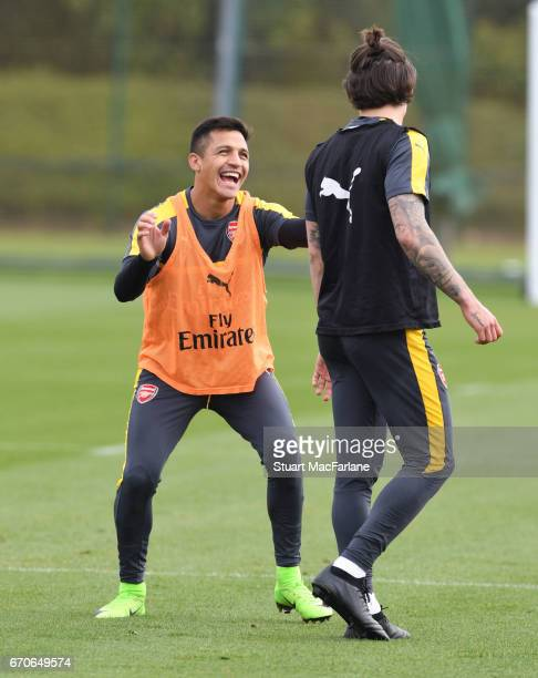 Alexis Sanchez and Hector Bellerin of Arsenal during a training session at London Colney on April 20 2017 in St Albans England