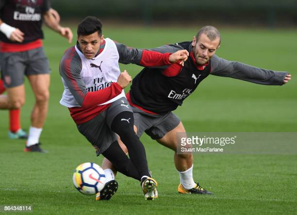 Alexis Sanchez and Jack Wilshere of Arsenal during a training session at London Colney on October 21 2017 in St Albans England