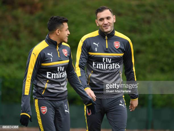 Alexis Sanchez and Lucas Perez of Arsenal before a training session at London Colney on May 9 2017 in St Albans England