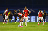 Alexis Sanchez and Mesut Oezil of Arsenal look dejected after the second Dinamo Zagreb goal during the UEFA Champions League Group F match between...