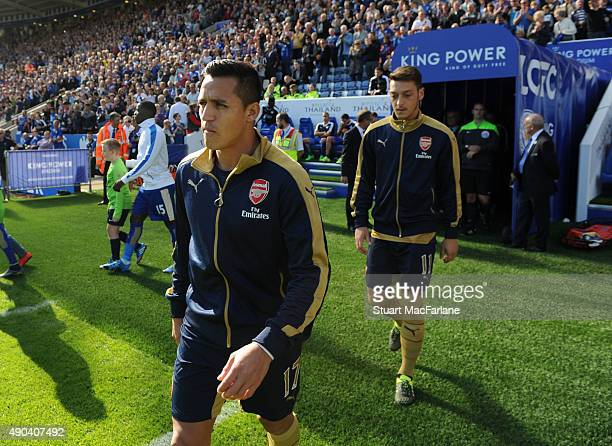 Alexis Sanchez and Mesut Ozil of Arsenal before during the Barclays Premier League match between Leicester City and Arsenal on September 26 2015 in...