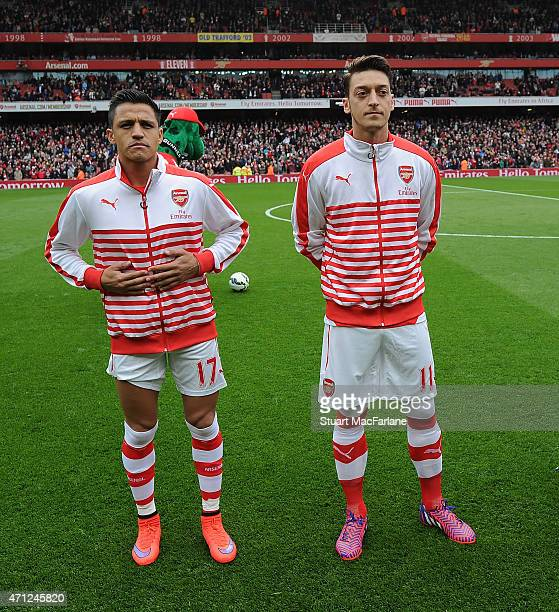 Alexis Sanchez and Mesut Ozil of Arsenal before the Barclays Premier League match between Arsenal and Chelsea at Emirates Stadium on April 26 2015 in...
