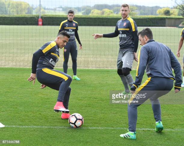 Alexis Sanchez and Mesut Ozil of Arsenal during a training session at London Colney on April 22 2017 in St Albans England