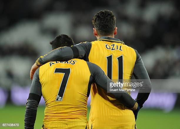 Alexis Sanchez and Mesut Ozil of Arsenal during the Premier League match between West Ham United and Arsenal at London Stadium on December 3 2016 in...