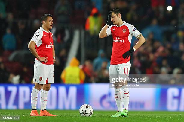 Alexis Sanchez and Mesut Ozil of Arsenal show their dejection after Barcelona's first goal during the UEFA Champions League round of 16 second Leg...