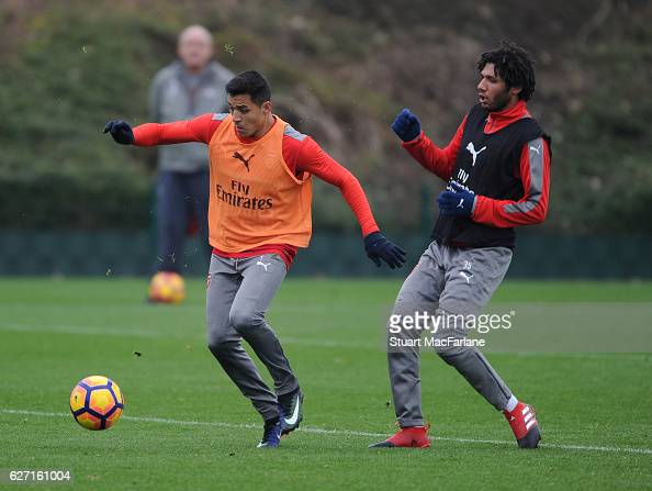 Alexis Sanchez and Mohamed Elneny of Arsenal during a training session at London Colney on December 2 2016 in St Albans England