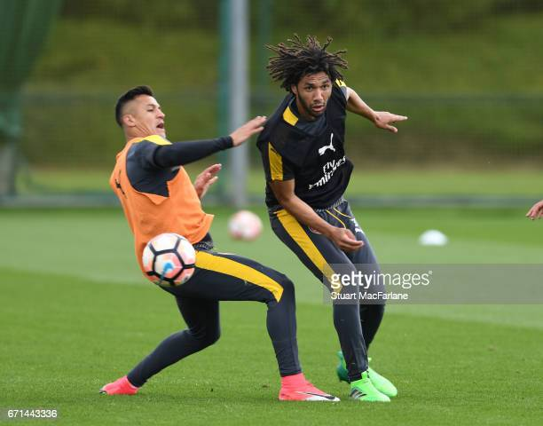 Alexis Sanchez and Mohamed Elneny of Arsenal during a training session at London Colney on April 22 2017 in St Albans England