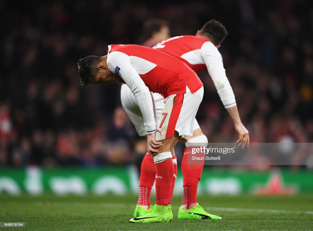 Alexis Sanchez and Olivier Giroud of Arsenal react during the UEFA Champions League Round of 16 second leg match between Arsenal FC and FC Bayern Muenchen at Emirates Stadium on March 7, 2017 in London, United Kingdom.
