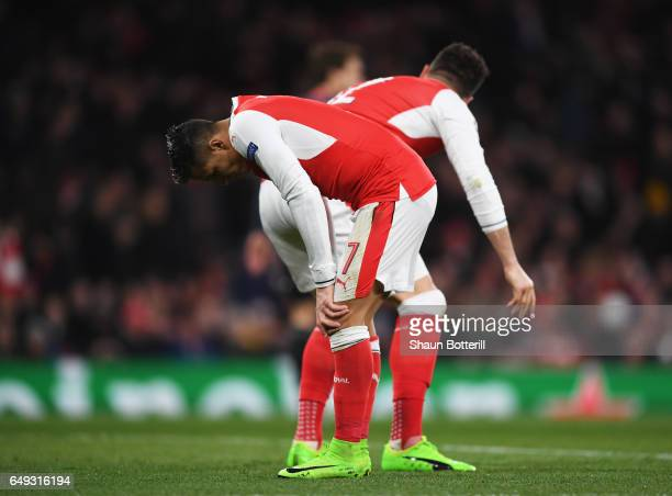 Alexis Sanchez and Olivier Giroud of Arsenal react during the UEFA Champions League Round of 16 second leg match between Arsenal FC and FC Bayern...
