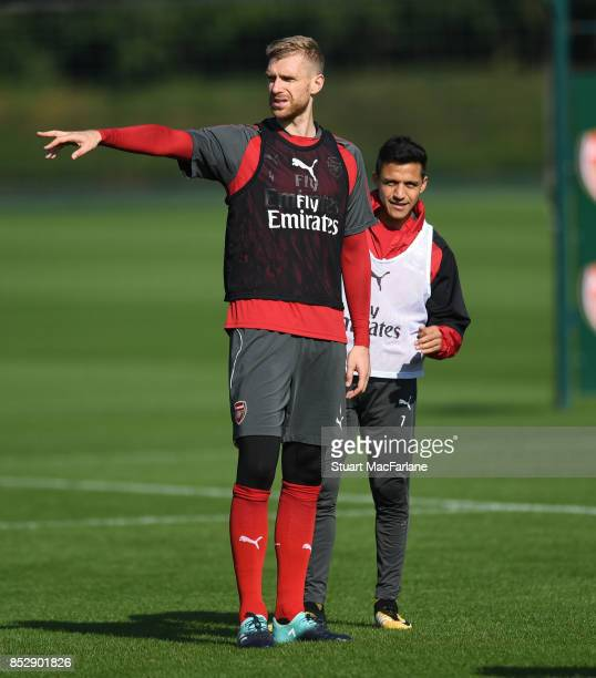 Alexis Sanchez and Per Mertesacker of Arsenal during a training session at London Colney on September 24 2017 in St Albans England