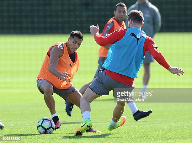 Alexis Sanchez and Shkodran Mustafi of Arsenal during a training session at London Colney on September 23 2016 in St Albans England