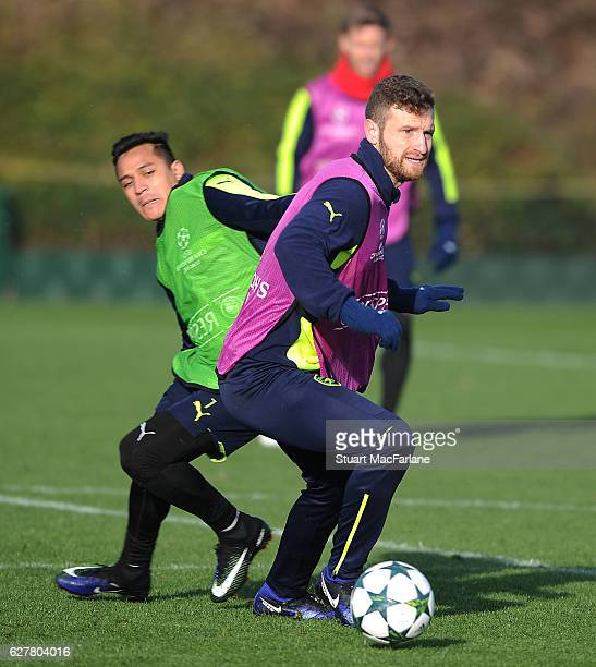 Alexis Sanchez and Shkodran Mustafi of Arsenal during a training session at London Colney on December 5 2016 in St Albans England