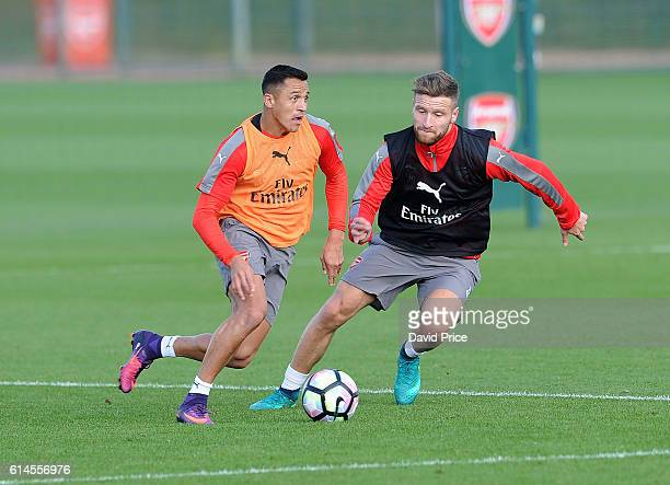 Alexis Sanchez and Shkodran Mustafi of Arsenal during Arsenal Training Session at London Colney on October 14 2016 in St Albans England