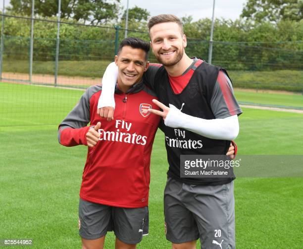 Alexis Sanchez and Shkodran Mustafi of Arsenal pose during a training session at London Colney on August 2 2017 in St Albans England