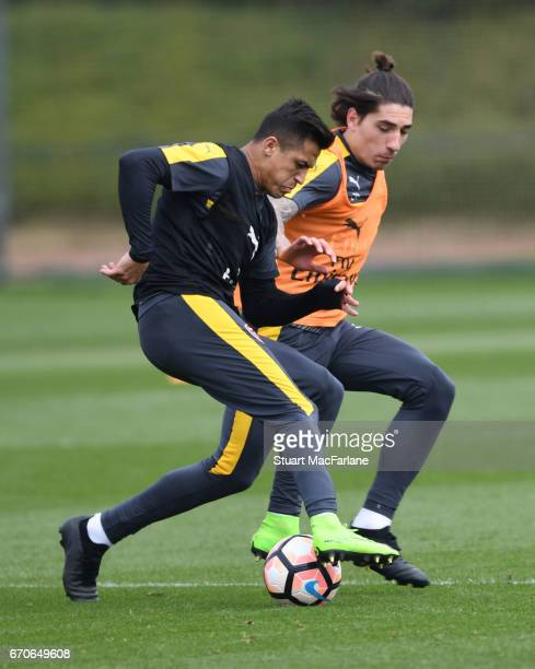 Alexis Sanchez andcHector Bellerin of Arsenal during a training session at London Colney on April 20 2017 in St Albans England