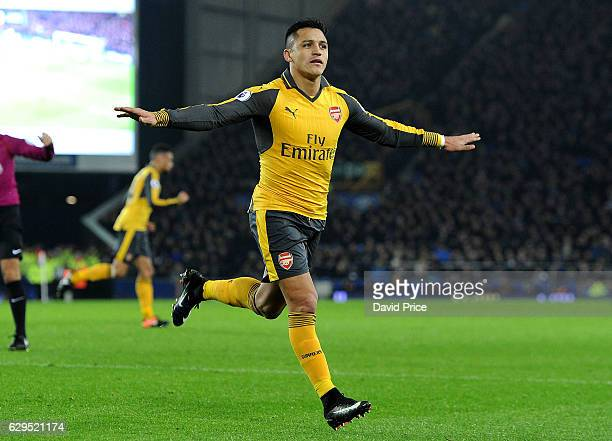 Alexis Sanchez celebrates scoring a goal for Arsenal during the Premier League match between Everton and Arsenal at Goodison Park on December 13 2016...