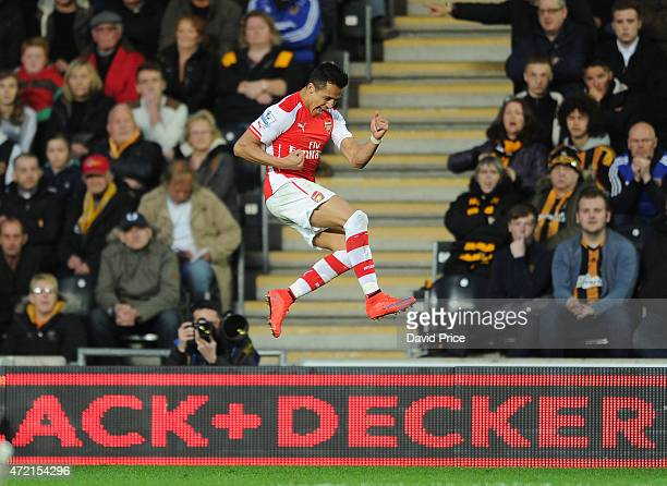 Alexis Sanchez celebrates scoring Arsenal's 1st goal during the match between Hull City and Arsenal at KC Stadium on May 4 2015 in Hull England