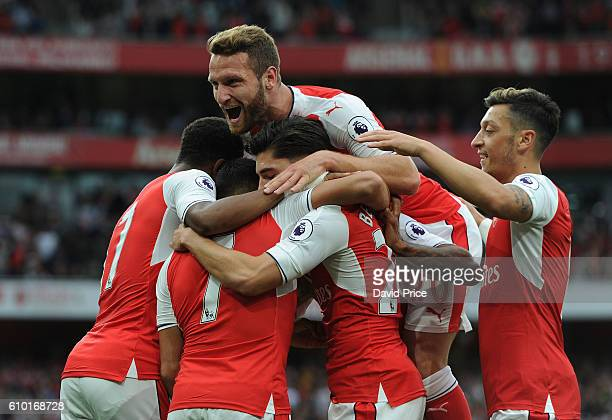 Alexis Sanchez celebrates scoring Arsenal's 1st goal with his team mates and Shkodran Mustafi during the Premier League match between Arsenal and...