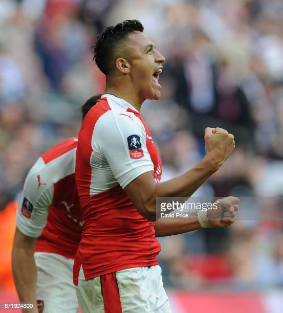 Alexis Sanchez celebrates scoring Arsenal's 2nd goal during the match between Arsenal and Manchester City at Wembley Stadium on April 23 2017 in...