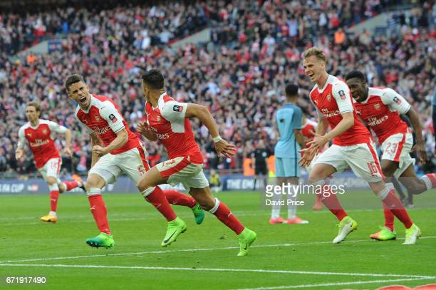 Alexis Sanchez celebrates scoring Arsenal's 2nd goal with Gabriel and Rob Holding during the match between Arsenal and Manchester City at Wembley...