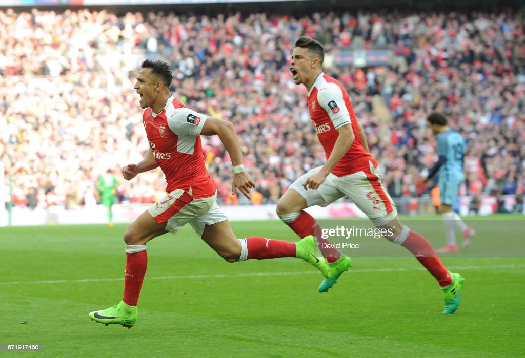Alexis Sanchez celebrates scoring Arsenal's 2nd goal with Gabriel during the match between Arsenal and Manchester City at Wembley Stadium on April 23, 2017 in London, England.