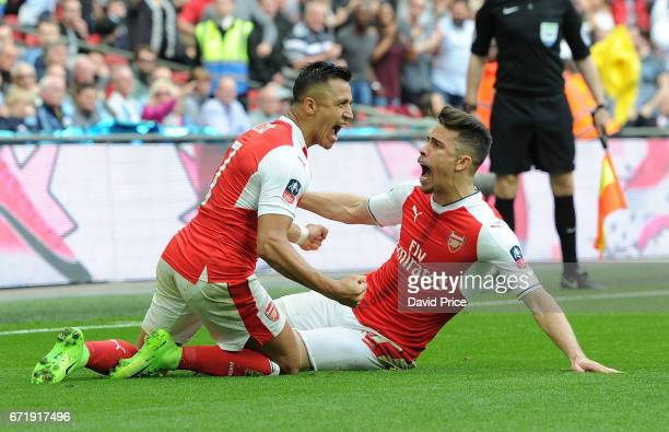 Alexis Sanchez celebrates scoring Arsenal's 2nd goal with Gabriel during the match between Arsenal and Manchester City at Wembley Stadium on April 23...