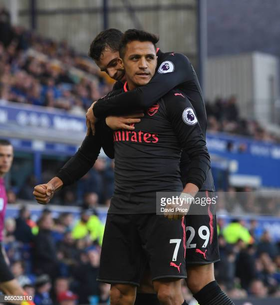 Alexis Sanchez celebrates scoring Arsenal's 5th goal with Granit Xhaka during the Premier League match between Everton and Arsenal at Goodison Park...