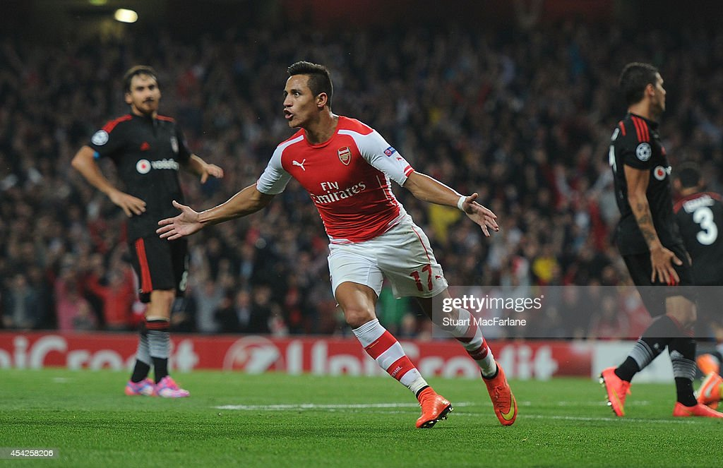 Alexis Sanchez celebrates scoring Arsenal's goal during the UEFA Champions League Qualifier 2nd leg match between Arsenal and Besiktas at Emirates Stadium on August 27, 2014 in London, United Kingdom.
