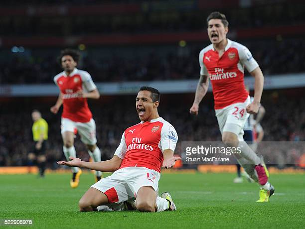 Alexis Sanchez celebrates scoring for Arsenal during the Barclays Premier League match between Arsenal and West Bromwich Albion at Emirates Stadium...