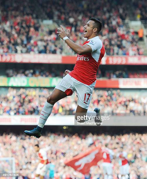 Alexis Sanchez celebrates scoring the 1st Arsenal goal during the Barclays Premier League match between Arsenal and Manchester United at Emirates...