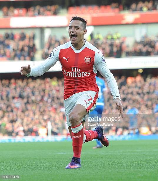 Alexis Sanchez celebrates scoring the 1st Arsenal goal during the Premier League match between Arsenal and AFC Bournemouth at Emirates Stadium on...