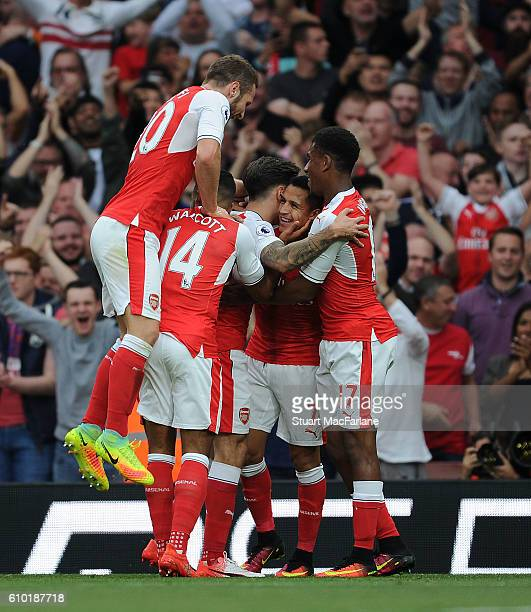 Alexis Sanchez celebrates scoring the 1st Arsenal goal with Alex Iwobi Shkodran Mustafi Theo Walcott and Hector Bellerin during the Premier League...