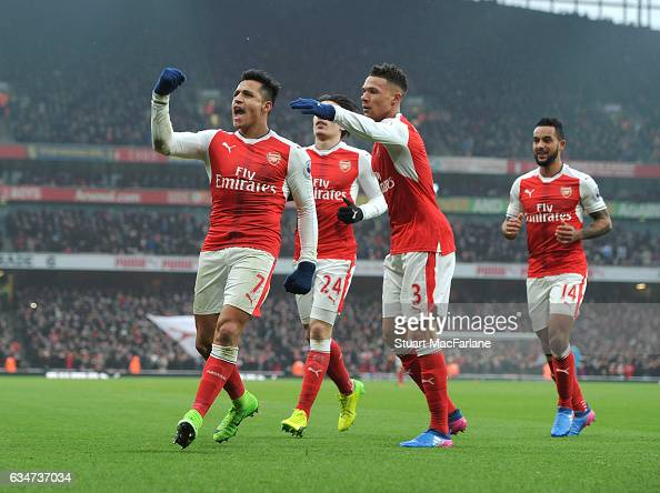 Alexis Sanchez celebrates scoring the 1st Arsenal goal with Kieran Gibbs during the Premier League match between Arsenal and Hull City at Emirates...