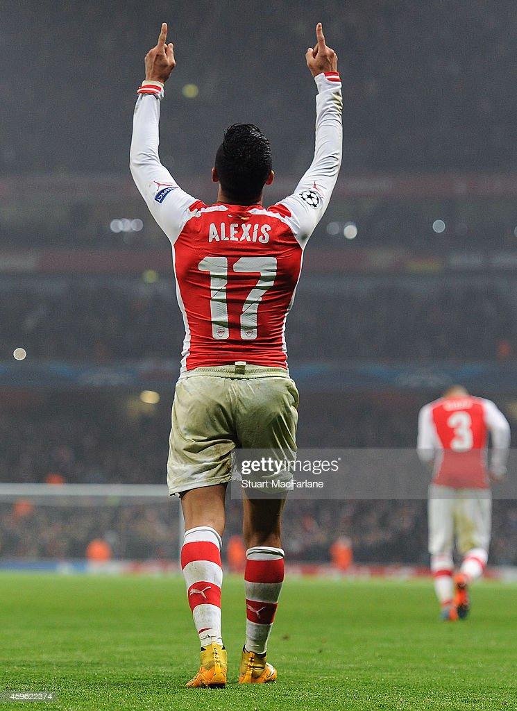 Alexis Sanchez celebrates scoring the 2nd Arsenal goal during the UEFA Champions League match between Arsenal and Borussia Dortmund at Emirates Stadium on November 26, 2014 in London, United Kingdom.