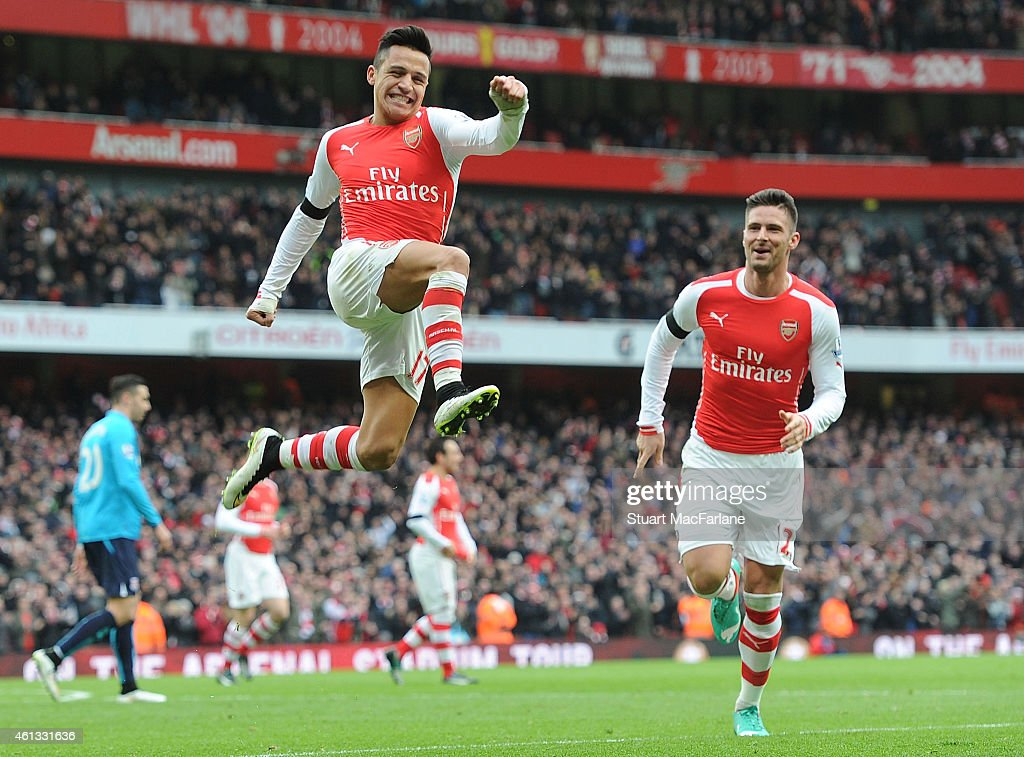 Alexis Sanchez celebrates scoring the 2nd Arsenal goal during the Barclays Premier League match between Arsenal and Stoke City at Emirates Stadium on January 11, 2015 in London, England.