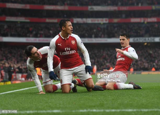 Alexis Sanchez celebrates scoring the 2nd Arsenal goal with Hector Bellerin and Granit Xhaka during the Premier League match between Arsenal and...