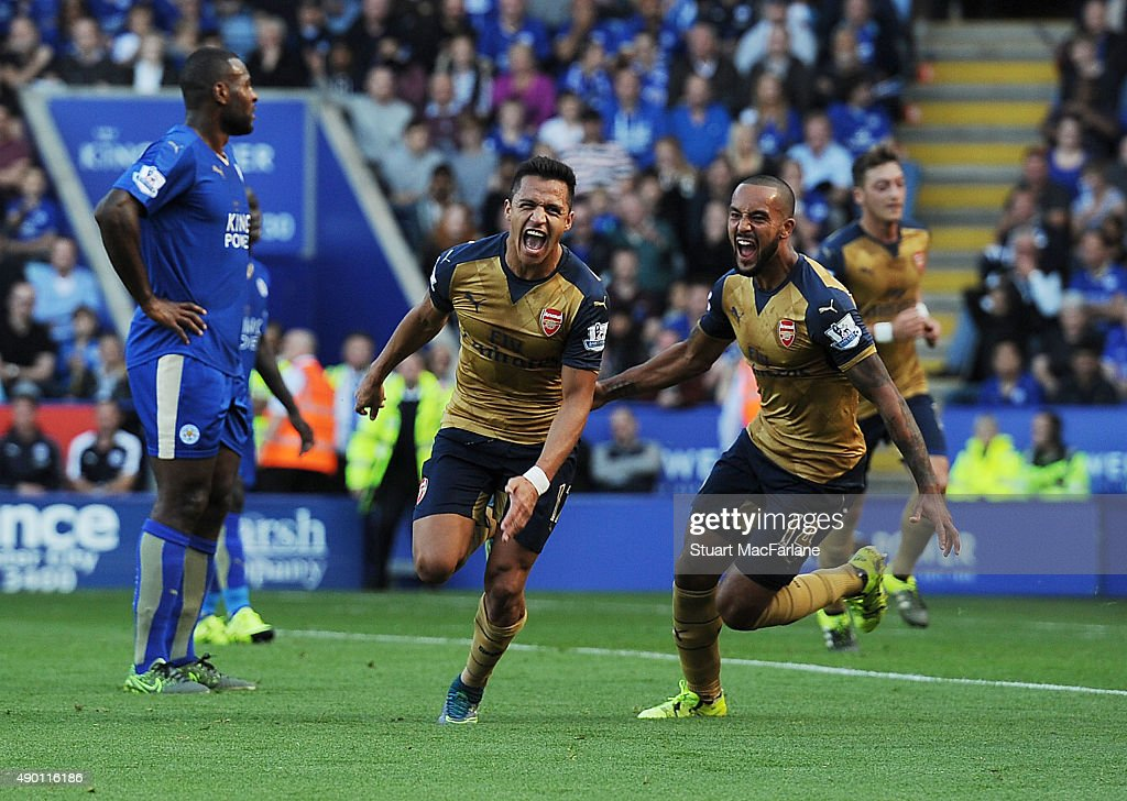 Alexis Sanchez celebrates scoring the 2nd Arsenal goal with Theo Walcott during the Barclays Premier League match between Leicester City and Arsenal on September 26, 2015 in Leicester, United Kingdom.