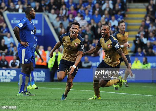 Alexis Sanchez celebrates scoring the 2nd Arsenal goal with Theo Walcott during the Barclays Premier League match between Leicester City and Arsenal...