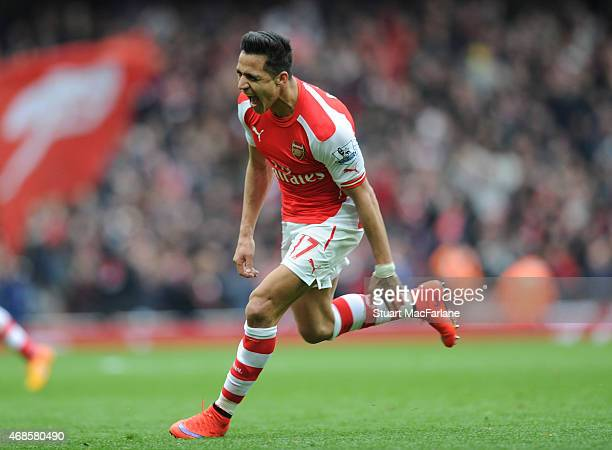 Alexis Sanchez celebrates scoring the 3rd Arsenal goal during the Barclays Premier League match between Arsenal and Liverpool at Emirates Stadium on...