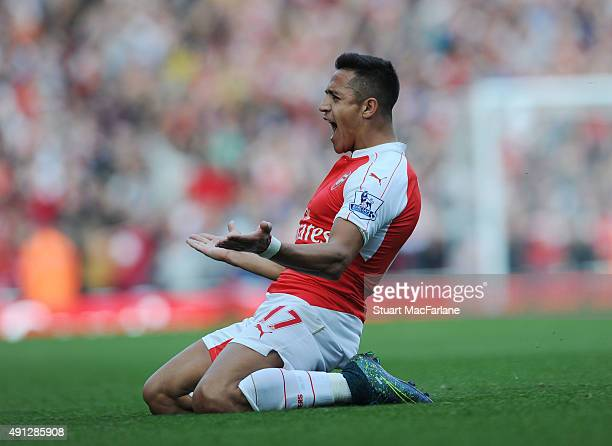 Alexis Sanchez celebrates scoring the 3rd Arsenal goal during the Barclays Premier League match between Arsenal and Manchester United at Emirates...